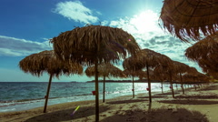 4K sunny summer timelapse tropical beach,bamboo umbrellas 30p Stock Footage