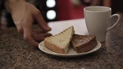 Barista hands give two sandwich and a cup of hot drink. Young man hands take it - stock footage