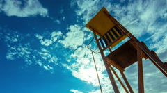 4K summer timelapse, beach, lifeguard tower, sun, blue sky 30p Stock Footage