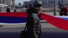 Young people carry a huge Russian flag Stock Footage