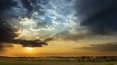 The picturesque sunset (sunrise) with rainy clouds, wide angle view Stock Footage