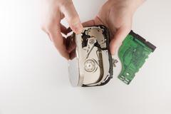 Hands repairing a hardware Stock Photos