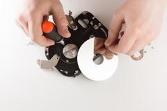 Hands repairing a hardware - stock photo