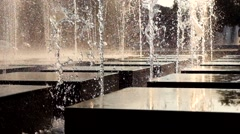 Modern fountain made of cubes working in summer day at sunset - stock footage