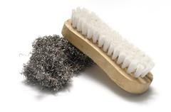 dirty wash brush and steel wool - stock photo