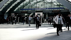 Commuters arriving at Canary Wharf station, London Stock Footage