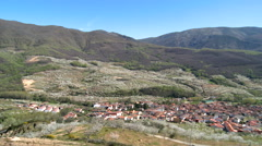 Pan village with red roofs in the valley of cherries - stock footage