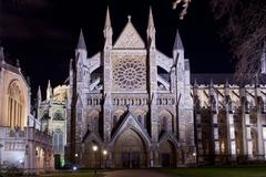 westminster abbey illuminated by night - stock photo