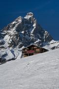 Chalet facing the Matterhorn - stock photo