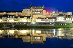 Chateau d'Amboise and reflections by night - stock photo