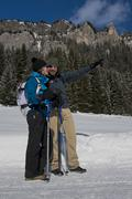 Couple of Hikers Pointing the Way on a snowy Trail Stock Photos