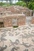 Ruins of roman thermal pool with mosaic Stock Photos