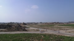Site preparation and infrastructure in river foreland Stock Footage