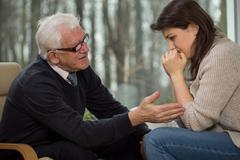 Psychotherapist comfort his client - stock photo