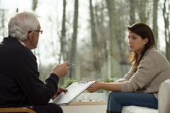 Psychiatris gives a diagnosis - stock photo