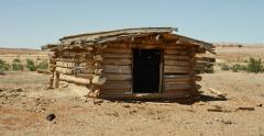 Ghost Town Abandoned Wild West Cabin Parched Desert Landscape Tracking Stock Footage