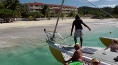 Grenada island Caribbean Sea 024 fasten catamaran at beach of Grand Anse Bay Stock Footage