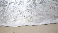 Sea waves with foam on  sandy beach - stock footage