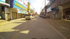 PATONG, THAILAND - CIRCA DEC 2013: Retreating shot of a typical urban street Stock Footage