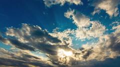 4K golden vivid heavenly sunset sky timelapse sun beams and light rays 30p Stock Footage