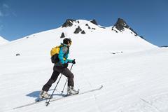 Ski mountaineer climb on skis on mountain - stock photo