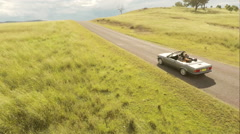 Aerial of Convertible on Country mountain Road Slow mo Stock Footage