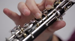 Stock Video Footage of musician playing clarinet, close up
