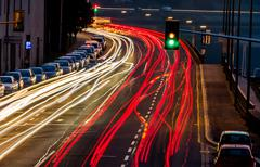 austria, linz. lights of moving cars - stock photo