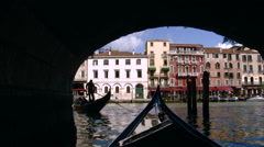 Venice - Antique Gondola entering large canal from under a bridge Stock Footage
