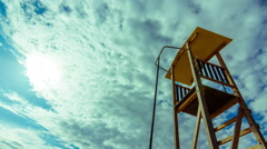 4K summer timelapse, beach, lifeguard tower, sun, blue sky 25p Stock Footage