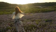 Woman Running in Bluebonnet Field. Stock Footage