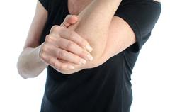 Woman with elbow pain Stock Photos
