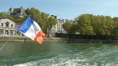 River Seine and french flag. Paris, France Stock Footage