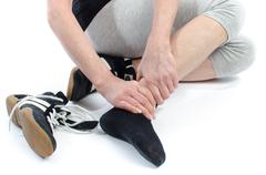 Woman with painful ankle Stock Photos