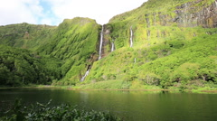 Waterfalls on Flores island and lake with lake in foreground, Azores archipelago Stock Footage