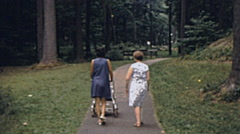 USA 1972: mother and grandmother walking at the park Stock Footage