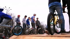 Bike trial on BMX. Young cyclists extremists practice in bike trial - stock footage