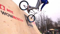 Bike trial on BMX. Young cyclists extremists practice in bike trial Stock Footage