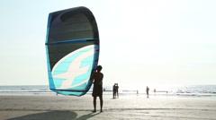 Man holding kite at sandy beach in Goa. Stock Footage