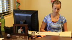 Secretary at Her Desk in GUAM, USA Stock Footage