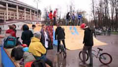 Bike trial on BMX. Young cyclists extremists practice in bike trial. - stock footage