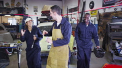 4K Portrait of cheerful team of male and female mechanics in garage workshop - stock footage