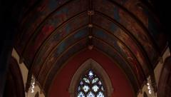 Tilt from Beautiful Ancient Christchurch Painted Ceiling to Altar and Stained - stock footage
