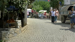Tractor coming toward camera on cobblestone street Sirince Village, Turkey - Stock Footage