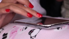 Typing and chatting on smartphones . Girl with red nails Stock Footage