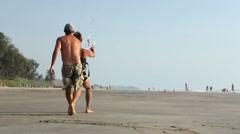 Men kiting at sandy beach in Goa. Stock Footage