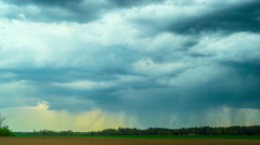 Rain clouds and rural landscape, panoramic time-lapse Stock Footage