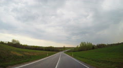 rural road and the rain clouds - stock footage