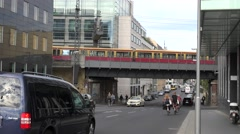 ULTRA HD 4K Traffic street Berlin city center suspended railway local train day  Stock Footage