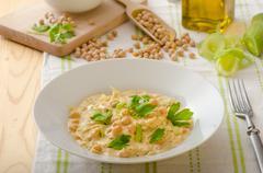 Chickpeas with paprika, cream sauce - stock photo